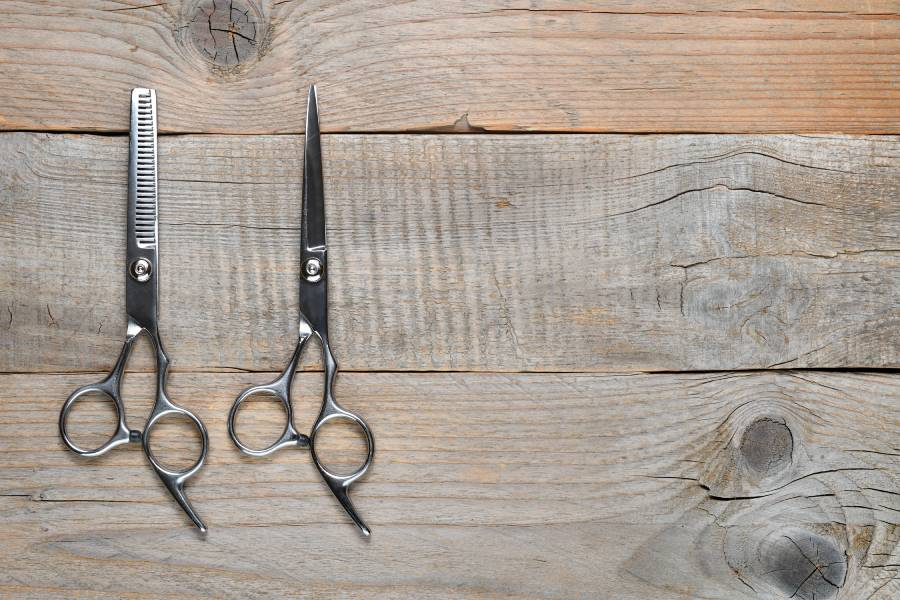 vintage-barber-scissors-on-old-wooden-table-top-vi-V6NP82T (1)